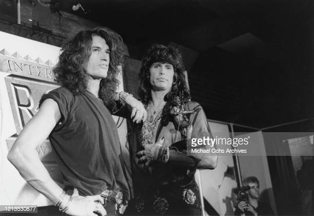 Guitarist Joe Perry and singer Steven Tyler of American rock band Aerosmith backstage at the International Rock Awards in New York City USA circa 1990