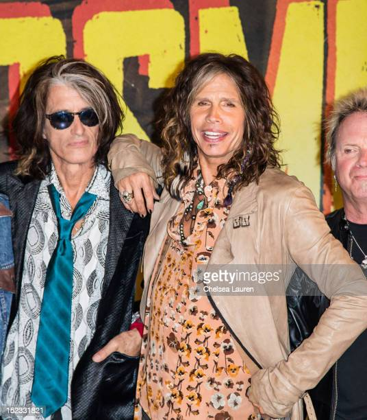 Guitarist Joe Perry and vocalist Steven Tyler of Aerosmith pose at House of Blues Sunset Strip on September 18 2012 in West Hollywood California