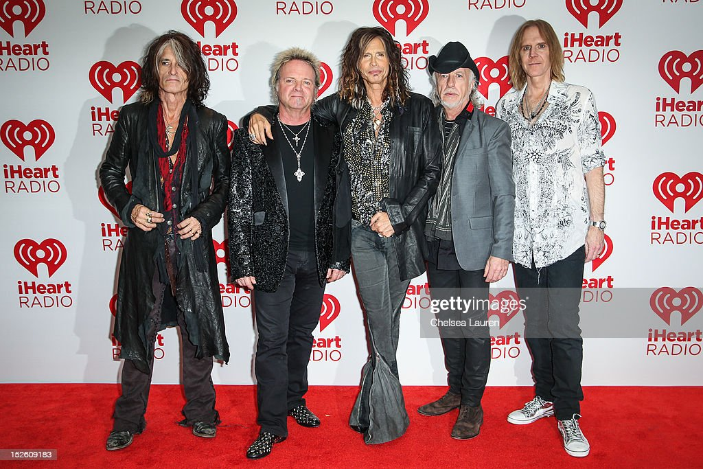 Guitarist Joe Perry, drummer Joey Kramer, vocalist Steven Tyler, guitarist Brad Whitford and bassist Tom Hamilton of Aerosmith arrive at iHeartRadio Music Festival press room at MGM Grand Garden Arena on September 22, 2012 in Las Vegas, Nevada.