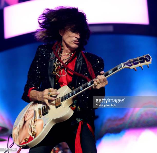 Guitarist Joe Perry of Aerosmith performs onstage during the 2012 iHeartRadio Music Festival at the MGM Grand Garden Arena on September 22 2012 in...