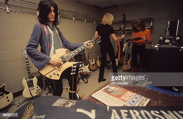 Guitarist Joe Perry with a BC Rich Mockingbird guitar Tom Hamilton and Joey Kramer of Aerosmith backstage at Madison Square Garden in New York City...