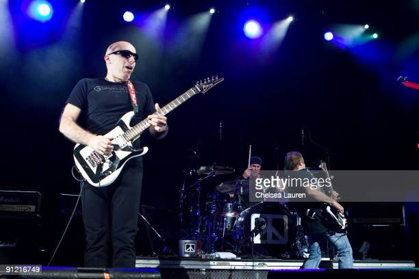 Guitarist Joe Satriani drummer Chad Smith and bassist Michael Anthony of Chickenfoot perform at the Gibson Amphitheatre on September 27 2009 in...