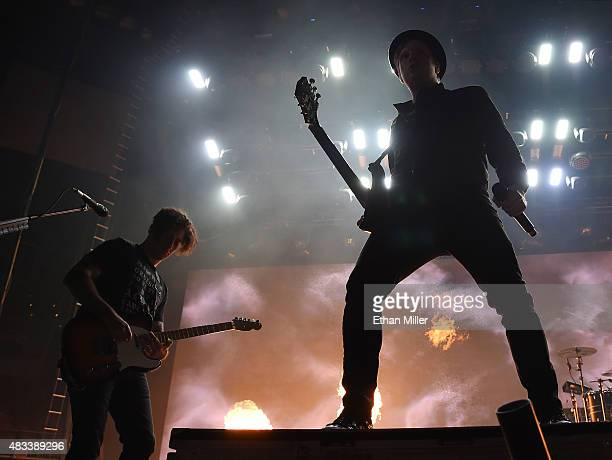 Guitarist Joe Trohman and frontman Patrick Stump of Fall Out Boy are silhouetted as they perform at the Mandalay Bay Events Center during a stop of...