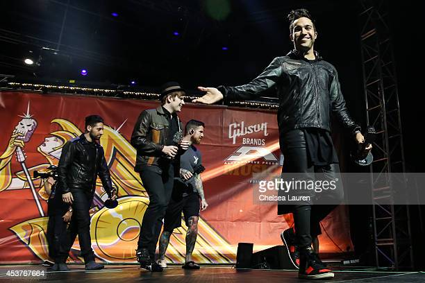 Guitarist Joe Trohman vocalist Patrick Stump drummer Andy Hurley and bassist Pete Wentz of Fall Out Boy accept the 'Artist of the Year' award at the...