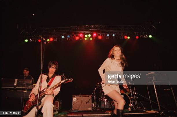 Guitarist Jon Spencer and singer Cristina Martinez of American rock group Boss Hog perform live on stage at Astoria II in London on 13th March 1996
