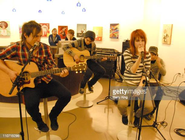 Guitarist Josh Farro and singer Hayley Williams of Paramore perform private concert for fans at Helio store on November 14 2007 in Santa Monica...