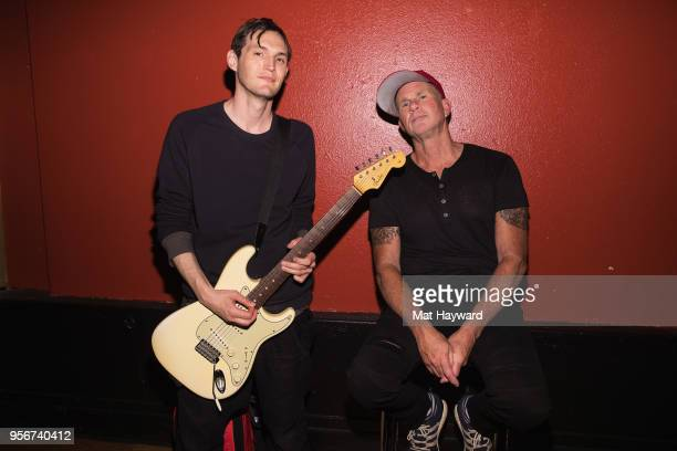 Guitarist Josh Klinghoffer and drummer Chad Smith of Red Hot Chili Peppers pose for a photo after rehearsal for the Musicares Concert for Recovery at...