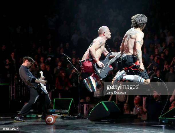 """Guitarist Josh Klinghoffer, bassist Michael """"Flea"""" Balzary and lead singer Anthony Kiedis of Red Hot Chili Peppers perform onstage at WFANs Big Hello..."""