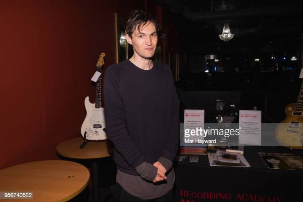 Guitarist Josh Klinghoffer of Red Hot Chili Peppers poses for a photo after rehearsal for the Musicares Concert for Recovery at the Showbox on May 9...