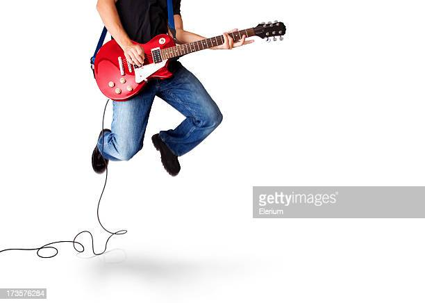 Guitarist jumping high in the air