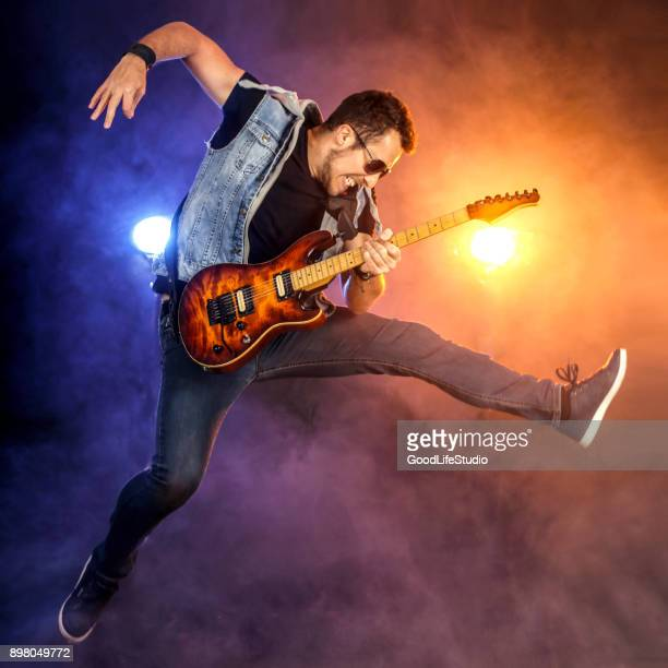 Guitarist jumping on stage