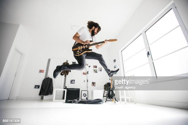 guitarist jumping - electric guitar stock pictures, royalty-free photos & images