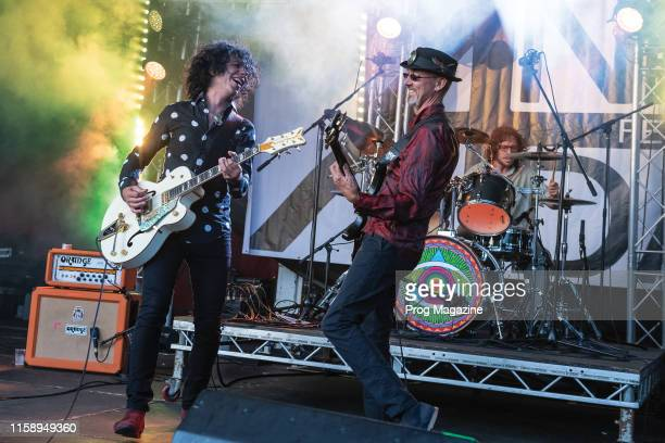 Guitarist Kavus Torabi and bassist Dave Sturt of British progressive rock group Gong performing live on stage during A New Day Festival at Mount...