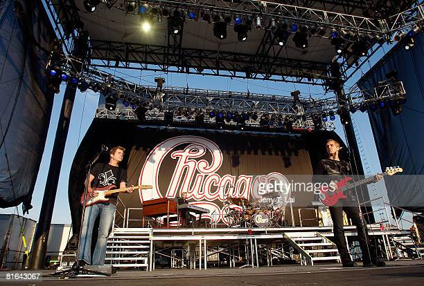 Guitarist Keith Howland and bassist Jason Scheff of the rock band Chicago perform on CBS' The Early Show at Charter One Pavilion on June 20 2008 in...