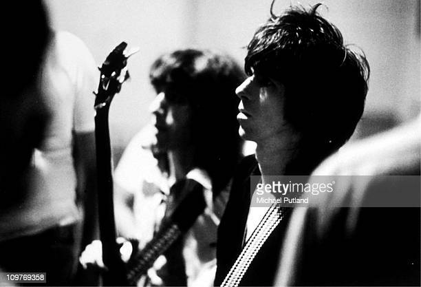 Guitarist Keith Richards and bassist Bill Wyman of the Rolling Stones backstage at the Festhalle in Frankfurt Germany in April 1976 as part of their...
