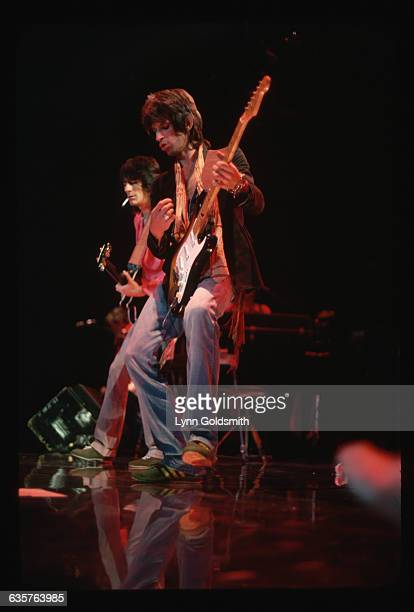 Guitarist Keith Richards and bassist Ron Wood perform during a Rolling Stones concert.