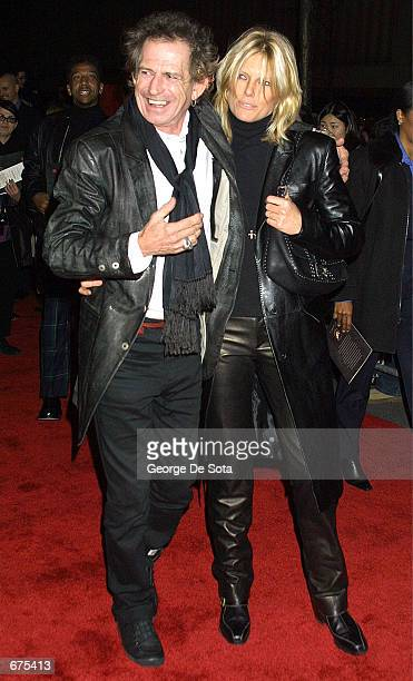 Guitarist Keith Richards and his wife Patti Hansen attend the premiere of Gosford Park December 3 2001 at the Ziefeld Theatre in New York City
