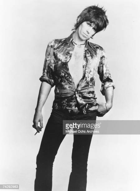 Guitarist Keith Richards of the rock band 'the Rolling Stones' poses for a portrait holding a cigarette in April of 1977
