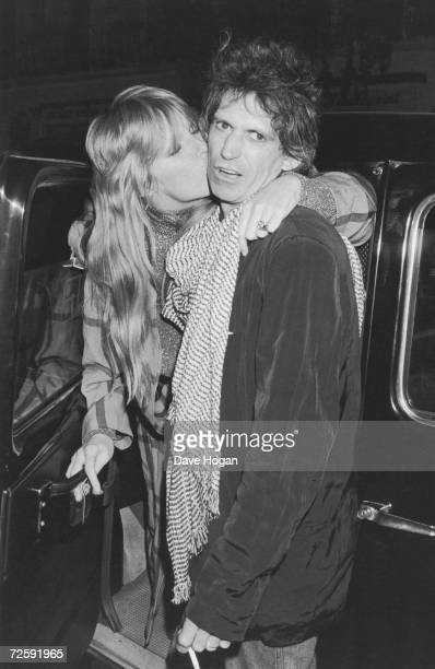 Guitarist Keith Richards of the Rolling Stones arrives at the San Lorenzo restaurant London with his wife Patti circa 1985