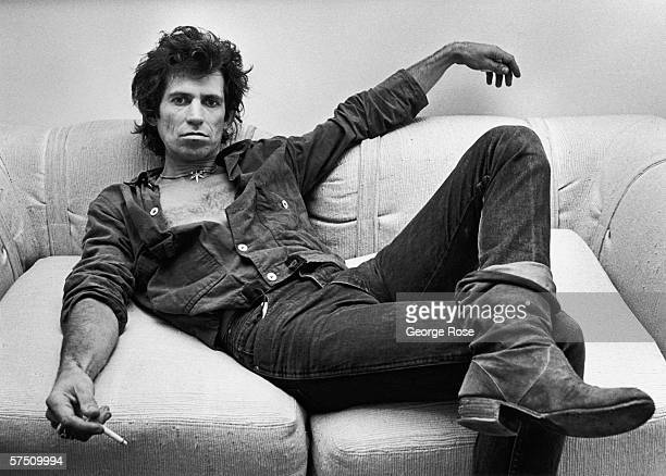 Guitarist Keith Richards of the Rolling Stones lounges in his New York City New York office during a 1980 portrait session