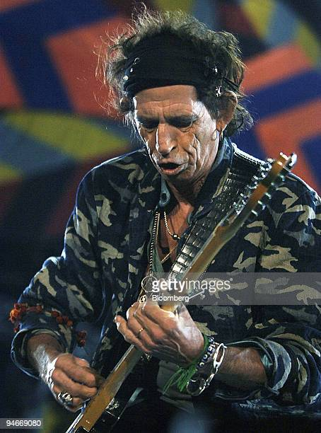 Guitarist Keith Richards of The Rolling Stones performs in front of an estimated 55000 people during their concert at Stadium Australia in Sydney...