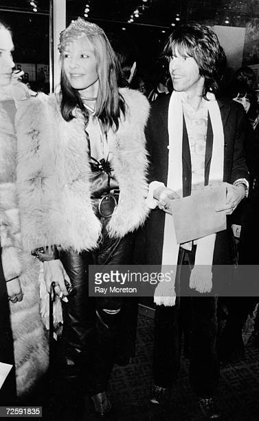 Guitarist Keith Richards of the Rolling Stones with his girlfriend Anita Pallenberg at the London premier of 'Performance' at the Warner West End...