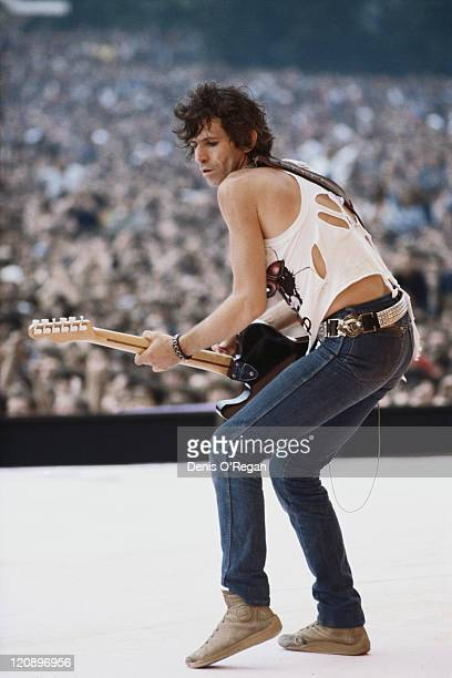 Guitarist Keith Richards performing on stage with the Rolling Stones, circa 1982.