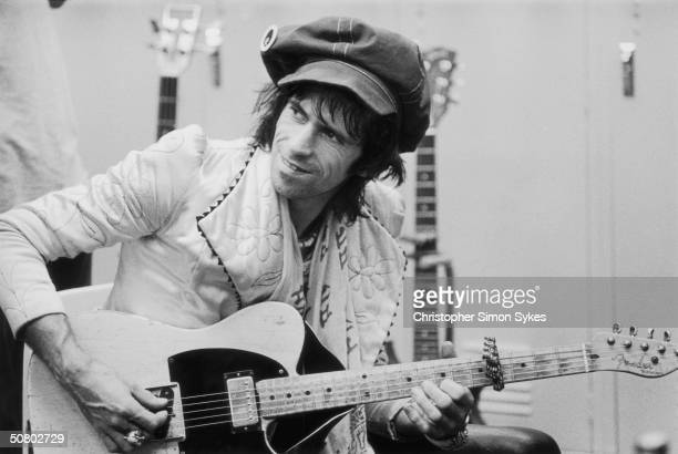 Guitarist Keith Richards strums backstage during the Rolling Stones Tour of the Americas 1975
