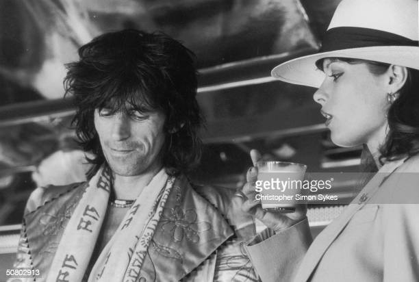 Guitarist Keith Richards with German actress Uschi Obermaier during the Rolling Stones' 1975 Tour of the Americas