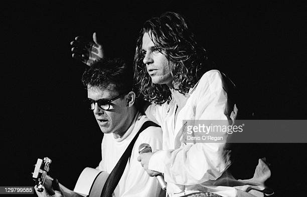 Guitarist Kirk Pengilly and singer Michael Hutchence performing with Australian rock group INXS at Wembley Arena London during the 'Kick' tour 24th...
