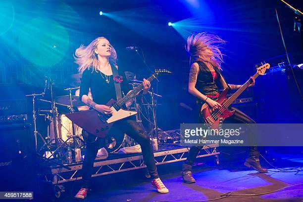 Guitarist Klara Force and bassist Ida Evileye of Swedish hard rock group Crucified Barbara performing live on stage at the 2013 Hard Rock Hell...