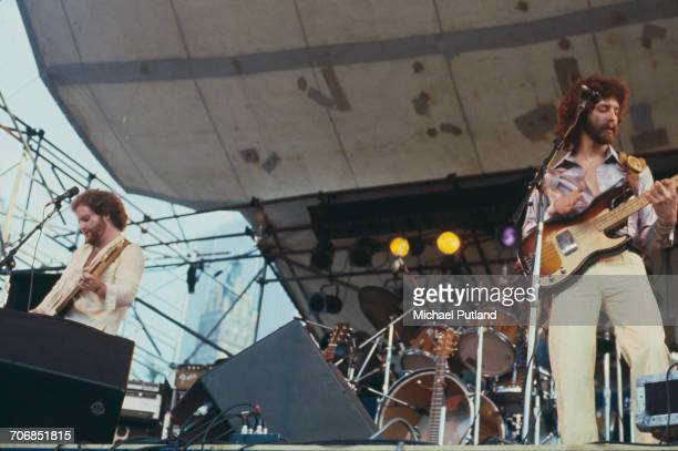 Guitarist Larry Hoppen and bass guitarist Lance Hoppen of American rock and pop group Orleans perform live on stage at the Dr Pepper Central Park...