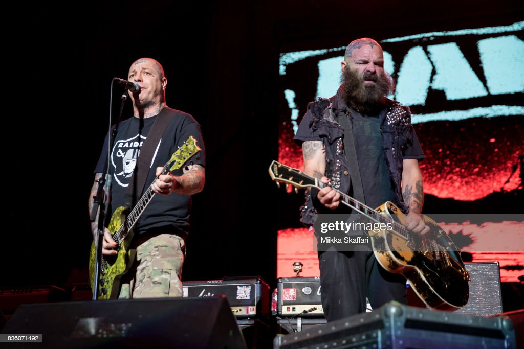 Guitarist Lars Frederiksen (L) and vocalist Tim Armstrong (R) of Rancid perform at The Greek Theater on August 20, 2017 in Berkeley, California.