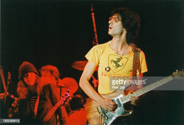 Guitarist Lenny Kaye performs on stage with Patti Smith in the background at Wembley Arena on September 5th 1979 in London England