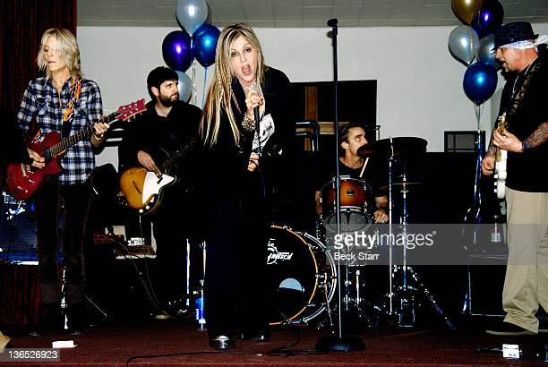 Guitarist Lexie Shine singer Nicky Trebek drummer Devon Dynomite and guitarist Anthony Gallo perform on New Year's Eve at United Methodist Church on...