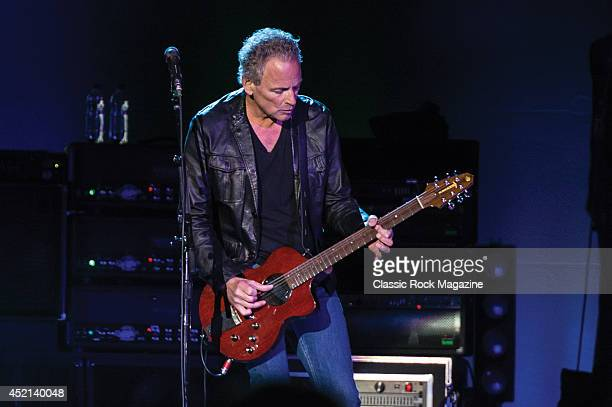 Guitarist Lindsey Buckingham of English rock group Fleetwood Mac performing live on stage at the O2 Arena in London, on September 27, 2013.