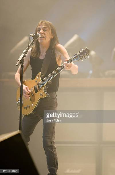 Guitarist Malcolm Young of the Australian rock band AC/DC performs in concert on their 'Black Ice World Tour' at the Conseco Fieldhouse on November 3...
