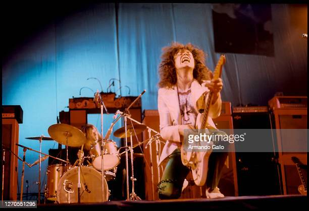 Guitarist Marc Bolan performs Live with Band T REX at the Wembley Arena in London 1973