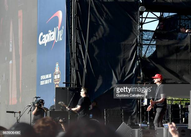 Guitarist Mark Hoppus drummer Travis Barker and guitarist Matt Skiba of blink182 perform at the Capital One JamFest during the NCAA March Madness...