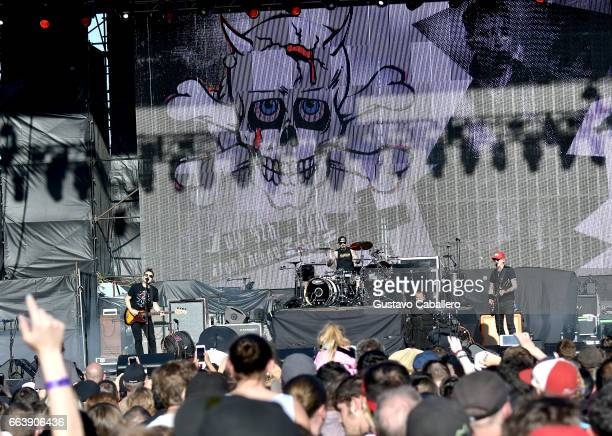 Guitarist Mark Hoppus drummer Travis Barker and singer Matt Skiba of blink182 perform at the Capital One JamFest during the NCAA March Madness Music...