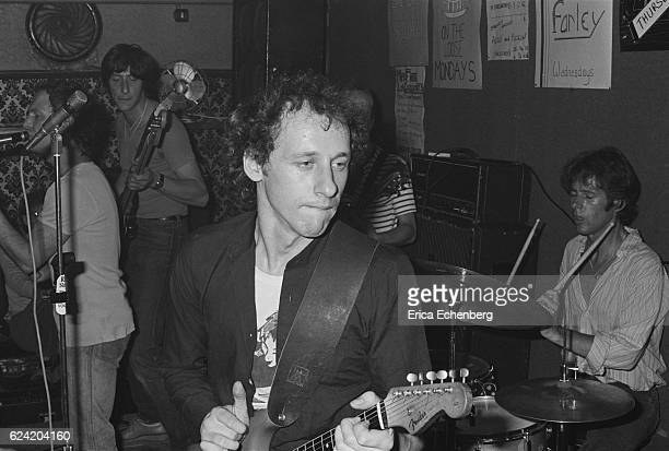 Guitarist Mark Knopfler and drummer Pick Withers both later of Dire Straits perform on stage with their eralier band Cafe Racers in a pub in Camden...