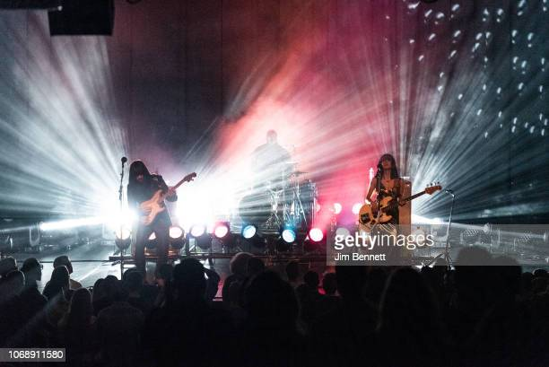 Guitarist Mark Speer , drummer Donald Johnson and bassist Laura Lee of Khruangbin perform live on stage at the Moore Theatre on November 16, 2018 in...