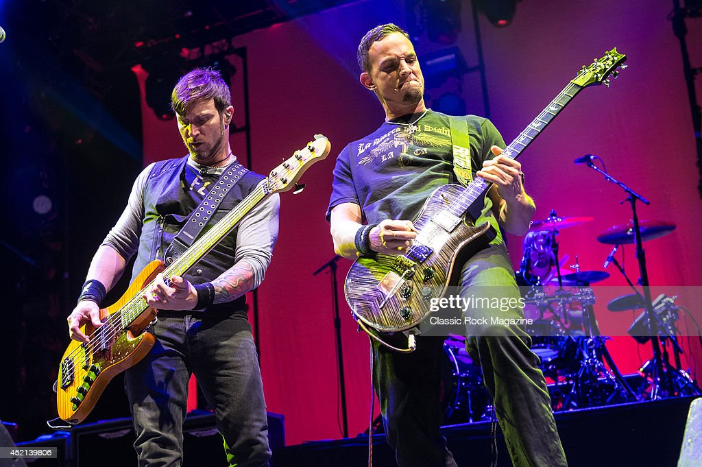 Guitarist Mark Tremonti (R) and bassist Brian Marshall of American rock group Alter Bridge performing live on stage at Wembley Arena in London, on October 18, 2013.