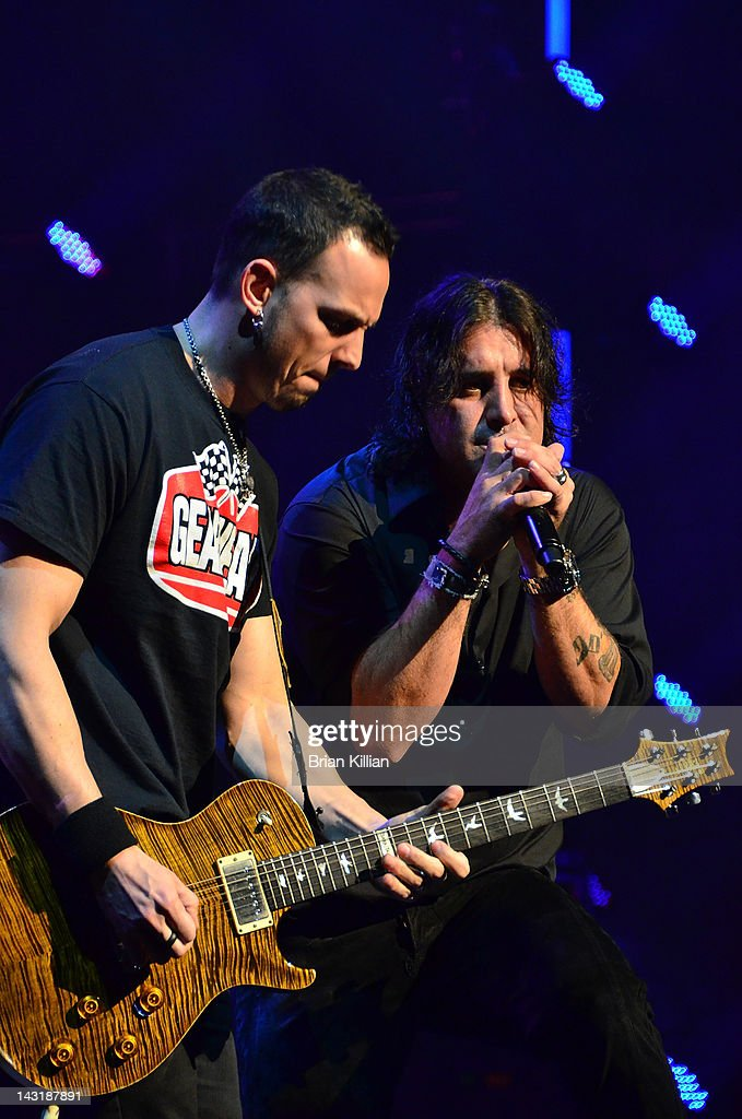 Guitarist Mark Tremonti and singer Scott Stapp of the band Creed perform at the Beacon Theatre on April 20, 2012 in New York City.