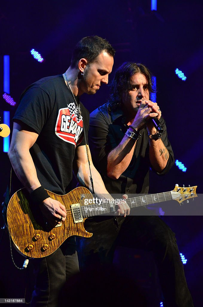 Guitarist Mark Tremonti and singer Scott Stapp of the group Creed perform at the Beacon Theatre on April 20, 2012 in New York City.