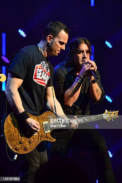 Guitarist Mark Tremonti and singer Scott Stapp of the group Creed perform at the Beacon Theatre on April 20 2012 in New York City