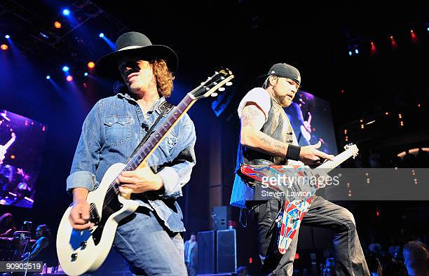 Guitarist Marlon Young and Guitarist Jason Krause perform on stage with Kid Rock at The Pearl concert theater inside of the Palms Casino Resort on...