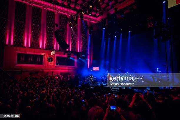 Guitarist Martin Gore singer Dave Gahan and keyboarder Andrew Fletcher of Depeche Mode perform live on stage during Telekom Street Gig at Funkhaus...