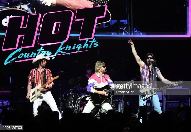 Guitarist Marty Ray Rayro Roburn recording artist Douglas Doug Douglason and bassist Trevor Travis of Hot Country Knights perform at The Chelsea at...