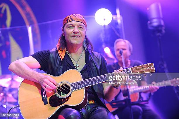 Guitarist Matthias Jabs and Mikael Nord Andersson special guest of German heavy metal band Scorpions perform during their 'MTV Unplugged Tour' at the...